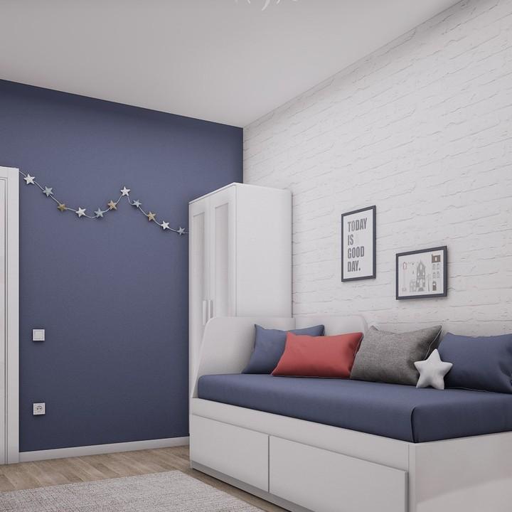 Белые обои под кирпич и синяя мебель
